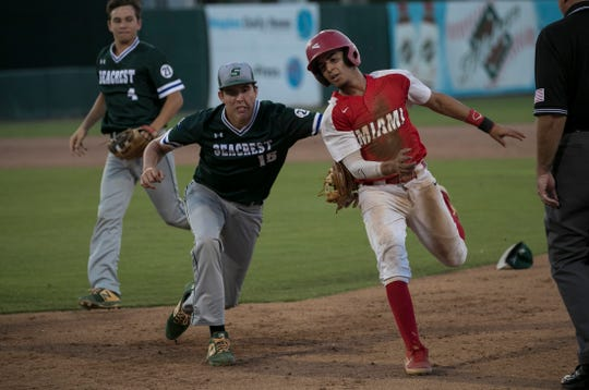 Andrew Geiger of Seacrest Country Day tags out Jakob Alvarez of Miami Christian on his way back to first base in the Class 2A state baseball finals at Hammond Stadium on Thursday in Fort Myers. Miami Christian won, 3-1.