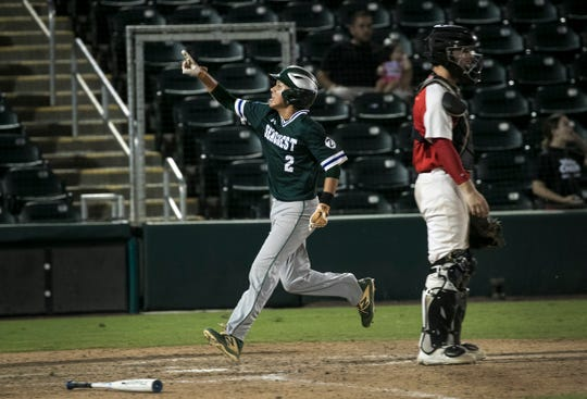 Jordan Martinez cheers as he scores the only run for Seacrest Country Day in their game against Miami Christian in the 2A state baseball finals at Hammond Stadium on Thursday, May 23, 2019, in Fort Myers.