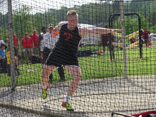 Amanda-Clearcreek senior Noah Smith competes in the discus on Thursday during the Division II regional meet at Lexington. Smith placed fourth to qualify for state.
