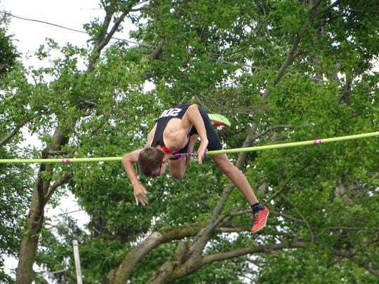 Liberty Union sophomore Jimmy Rhoads nearly clears 15-feet-9 on Thursday during the Division II regional meet at Lexington. Rhoads earlier won the title with a vault of 15-0.