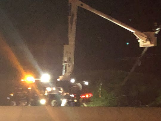 Route 23 was closed in both directions May 23, 2019 in Butler after a two-car crash knocked down a utility pole and brought wires down across the highway.