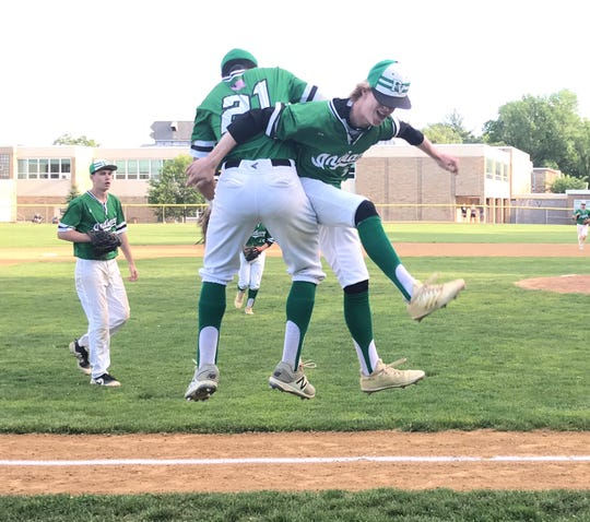 Third baseman Justin Martin (21) and pitcher Cole Porter celebrate Pascack Valley's 5-2 win over Indian Hills in the North 1, Group 3 baseball quarterfinals on Friday, May 24, 2019.