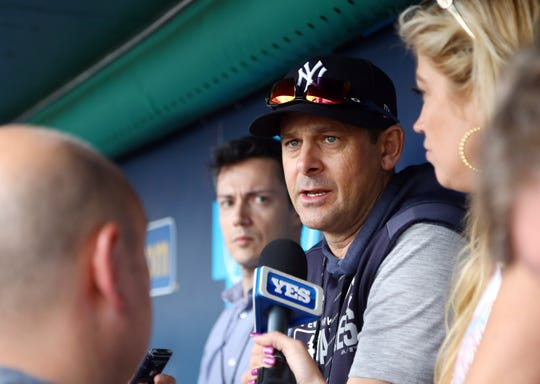 May 24, 2019; Kansas City, MO, USA; New York Yankees manager Aaron Boone (17) talks to reporters before the game against the Kansas City Royals at Kauffman Stadium was rained out. Weather permitting, the game will be made up as part of a day-night doubleheader on Saturday, with start times scheduled for 2:15 p.m. ET and 8:15 p.m. ET.