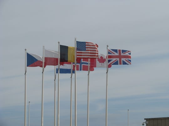 Flags of the Allied Forces that participated in the Normandy invasion on June 6, 1944, fly recently near a museum in the seaside town of Arromonches-les-Bains, France. The town is the site of Gold Beach where British soldiers stormed ashore during during the Normandy invasion.