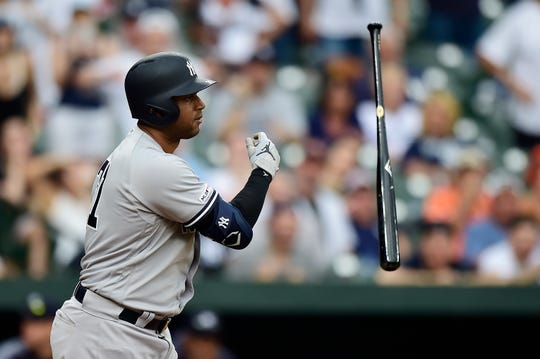 Aaron Hicks of the New York Yankees tosses his bat after being walked with the bases loaded scoring Gleyber Torres  (not pictured) in the ninth inning against the Baltimore Orioles at Oriole Park at Camden Yards on May 23, 2019 in Baltimore, Maryland.