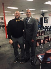 Tim McClurg, left, was officially approved as West Milford boys' varsity basketball coach at Tuesday's regularly-scheduled Board of Education meeting. Superintendent of Schools Alex Anemone congratulates McClurg after the meeting.
