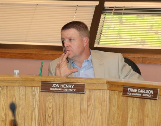Jon Henry, chairperson of the Eddy County Board of Commissioners, leads a  May 21 meeting approving a combined $15,000 donation for new tactical equipment for the Eddy County Sheriff's Office.