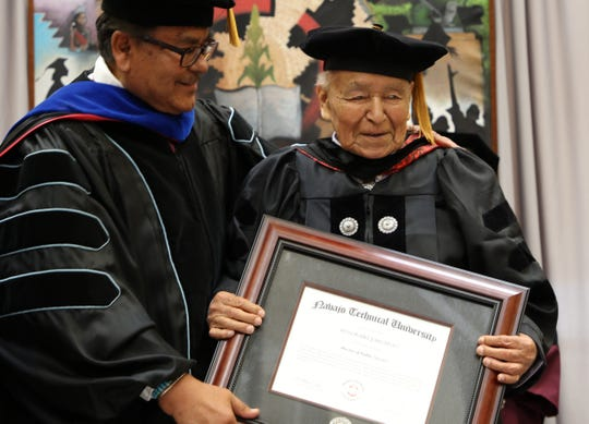 State Sen. John Pinto receives an honorary doctor of public service degree from Navajo Technical University on May 17 in Crownpoint.