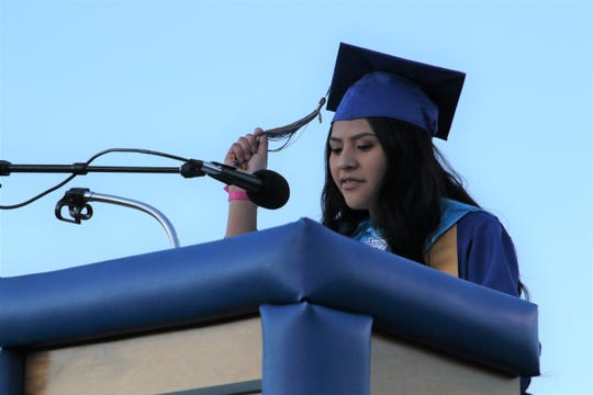 Bloomfield High School graduate Macailah Pablo leads the graduates in the ring and tassel ceremony during the commencement ceremony on May 23 at Bobcat Stadium.
