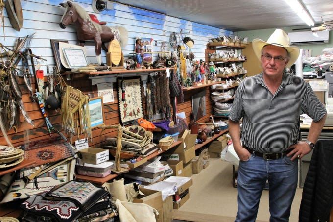 Owner John McCulloch stands in his office at the Teec Nos Pos Trading Post in Arizona, one of the few traditional trading posts still operating in the area.