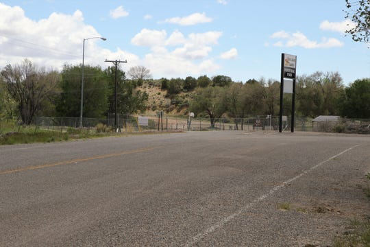 The entrance road to San Juan County Industrial Park is pictured, Thursday, May 23, off of the La Plata Highway.