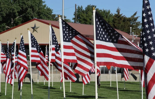 Flags are displayed, Friday, May 24, 2019, in the Healing Field at the Boys & Girls Clubs of Farmington.