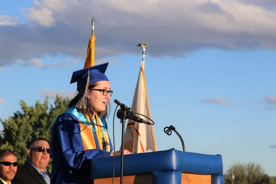 Bloomfield High School Salutatorian Hannah Ellsworth speaks to the crowd during the commencement ceremony on May 23 at Bobcat Stadium.