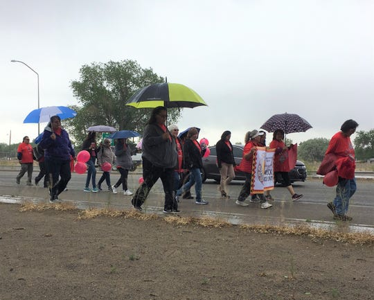Walkers proceed along U.S. Highway 64 in Shiprock on May 23 to raise awareness about the issue of missing and murdered indigenous women and girls.