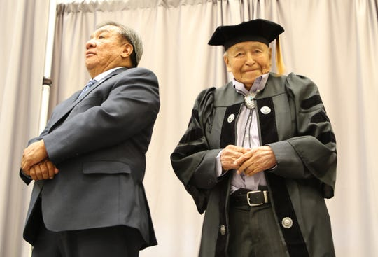 From left, state Sens. Benny Shendo Jr. and John Pinto attend Navajo Technical University's spring commencement on May 17 in Crownpoint. Pinto received the university's first honorary doctoral degree.