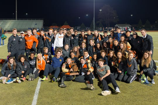 The Northville track and field teams pose after their high finishes at regionals.
