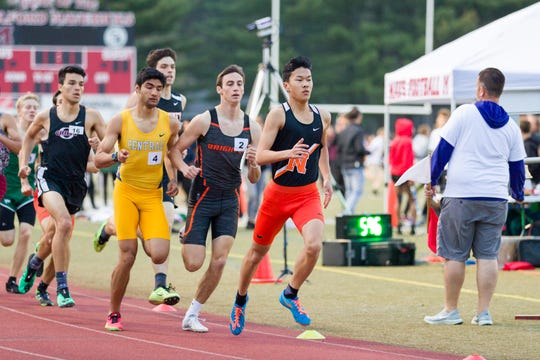 Northville's Raymond Jiang runs in the 800 at regionals.