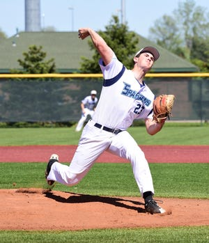 Livonia Stevenson's Nate Waligora delivers a pitch against Brighton in the KLAA title game last season. He has signed with Hillsdale College to continue his playing career.