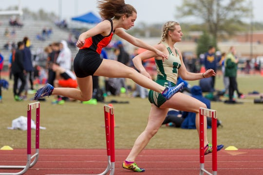 Northville's Lexi Davenport runs in the 300 hurdles.