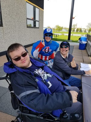 Ross Kleinschmit (Left) livestreams a game with Logan (Center) and Mason (Right) Seckar.