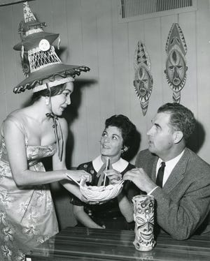 Janice and Frank Bogert chat with the waitress at Aloha Jhoe's.