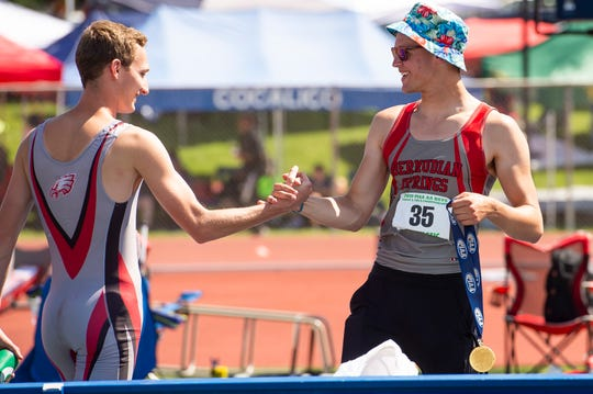 Bermudian Springs' Kolt Byers, right, is congratulated by teammate Payton Rohrbaugh after winning the 2A boys high jump at 6-7 during the PIAA track and field championships at Shippensburg University on Friday, May 24, 2019.