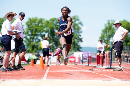 West York's Tesia Thomas competes in the 3A triple jump during the PIAA track and field championships at Shippensburg University on Friday, May 24, 2019.