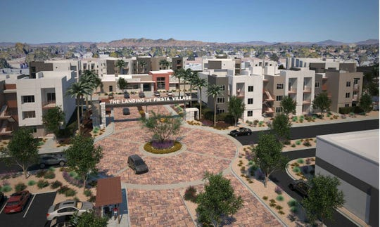 A conceptual image of an apartment complex and commercial development proposed for the northwest corner of Alma School Road and Southern Avenue in Mesa.
