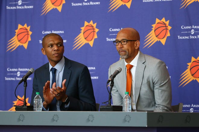 General manager James Jones (left) introduces Monty Williams as the new head coach of the Phoenix Suns during a press conference on May 21, 2019 at Talking Stick Resort Arena in Phoenix, Ariz.