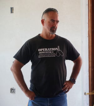 Charlie Ellis helps oversee the renovation as Operation Enduring Gratitude remakes Gilbert Lopez's home in Glendale on May 18, 2019.