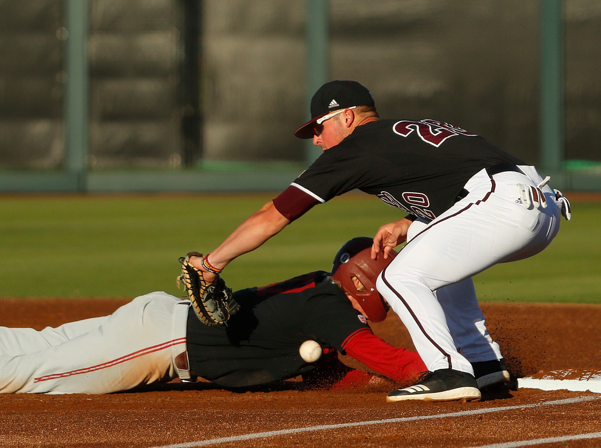 Standford's Kyle Stowers (37) slides safely back into first before a tag from ASU's Spencer Torkelson (20) during the first inning at Phoenix Municipal Stadium in Phoenix, Ariz. on May 23, 2019.