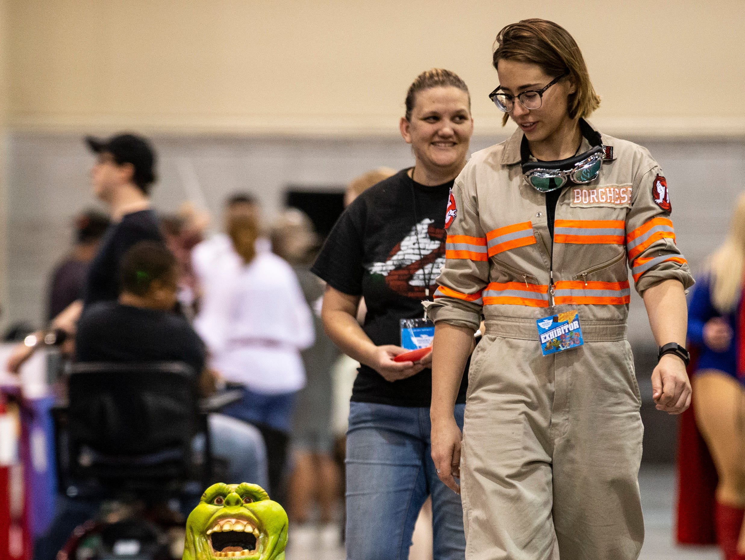RJ Russell (left) and Desiree Borghese drive Slimer around during Day 1 of Phoenix Fan Fusion on May 23, 2019, at the Phoenix Convention Center.