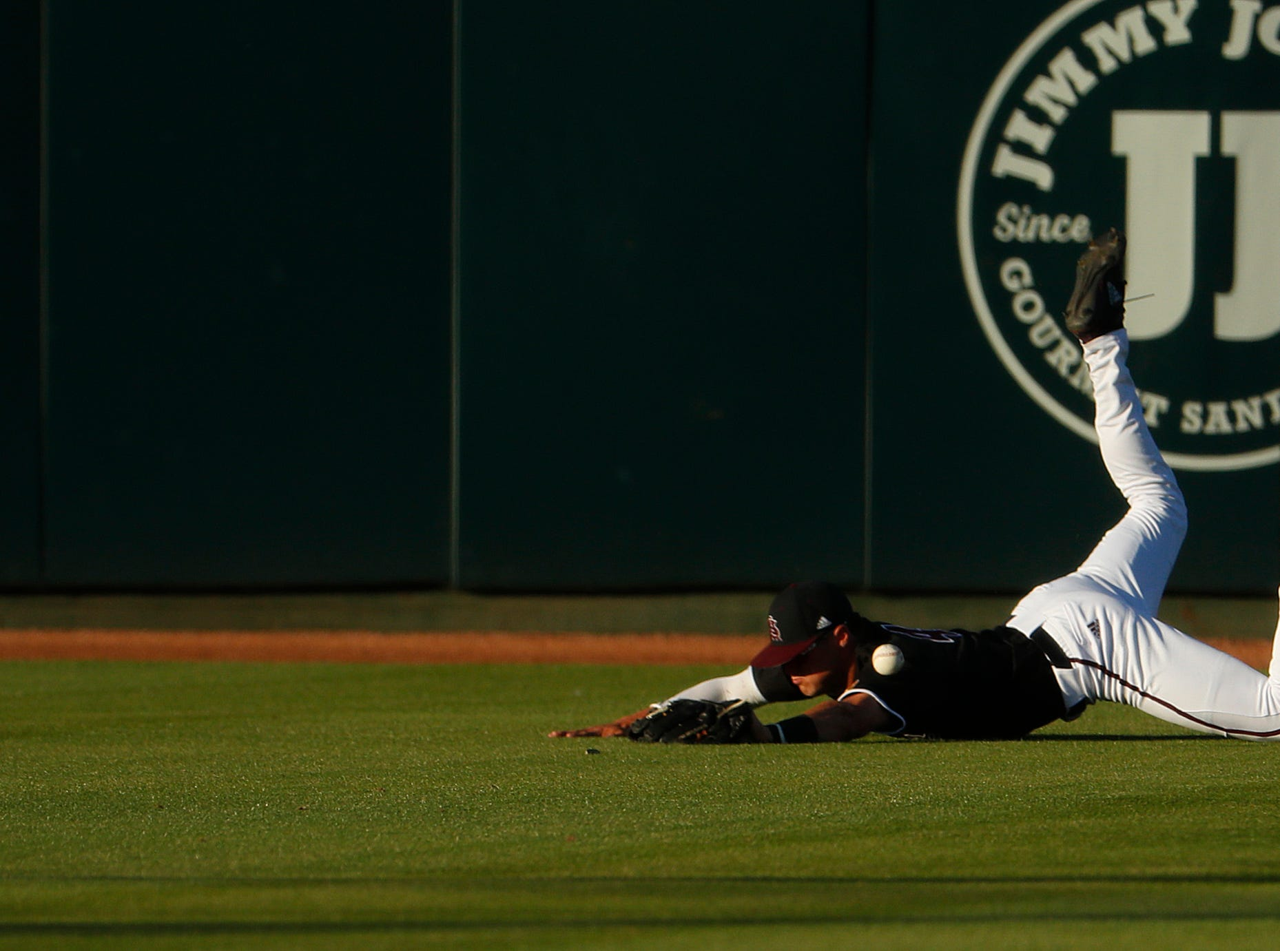 ASU's Hunter Bishop (4) dives for a ball but is unable to come up with the catch against Stanford at Phoenix Municipal Stadium in Phoenix, Ariz. on May 23, 2019.