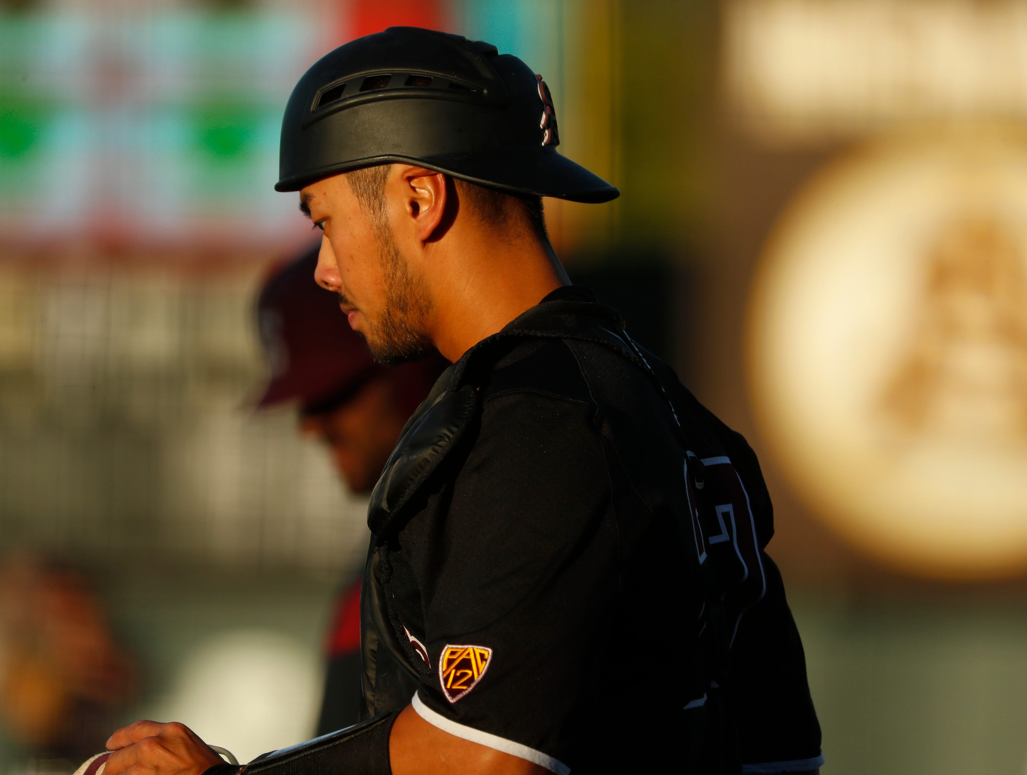 ASU's catcher Lyle Lin (27) heads back to home plate after a foul ball against Stanford at Phoenix Municipal Stadium in Phoenix, Ariz. on May 23, 2019.