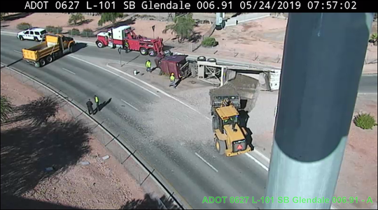 A semi rollover blocks access Loop 101 on ramp in Glendale
