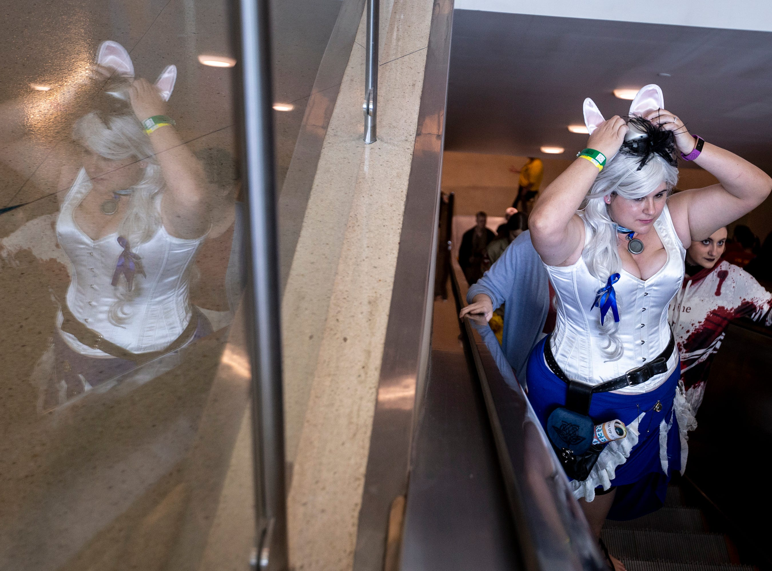 Allyx Blakesley rides an escalator during Day 1 of Phoenix Fan Fusion on Thursday, May 23, 2019, at the Phoenix Convention Center in Phoenix.