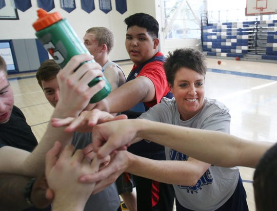 Michelle Berry, right, led The Gregory School's boys and girls basketball teams three years ago.