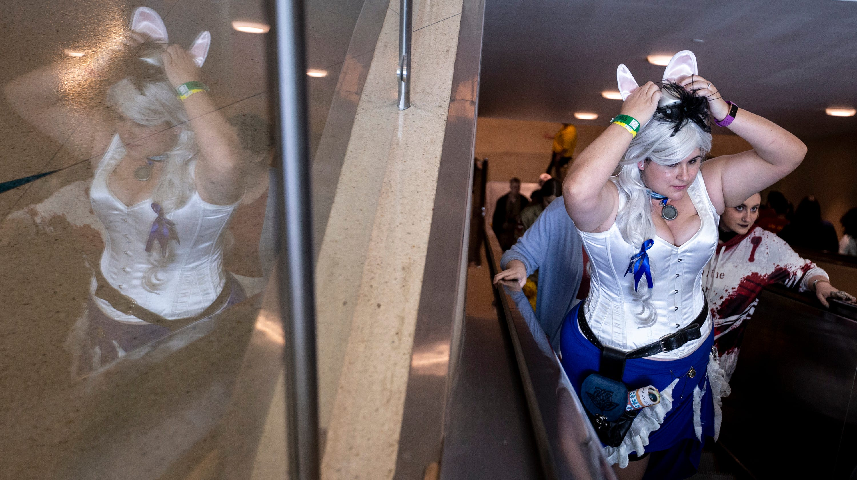 Allyx Blakesley rides an escalator during Day 1 of Phoenix Fan Fusion on May 23, 2019, at the Phoenix Convention Center.