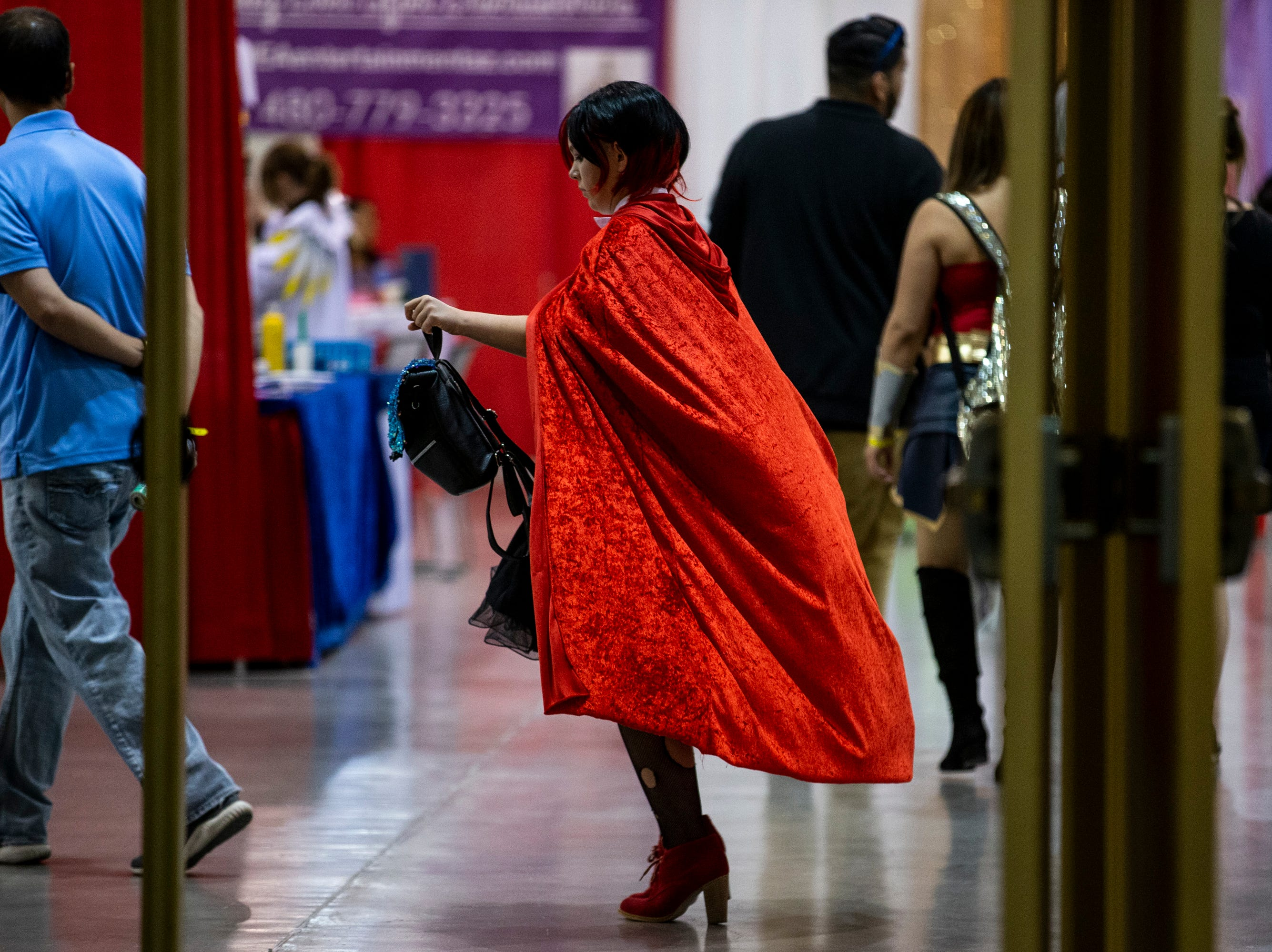 An attendee walks around during Day 1 of Phoenix Fan Fusion on May 23, 2019, at the Phoenix Convention Center.