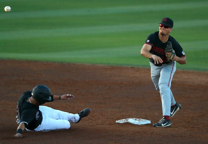 Stanford's Duke Kinamon records an out on ASU's Carter Aldrete (21) before throwing to first for the double play at Phoenix Municipal Stadium in Phoenix, Ariz. on May 23, 2019.