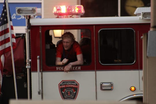TJ Caton enjoyes the team's fire truck parade through Palmyra.