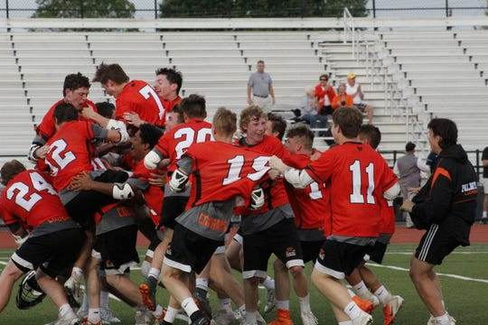 No. 3 seed Palmyra celebrates its district win over No. 1 Manheim Township