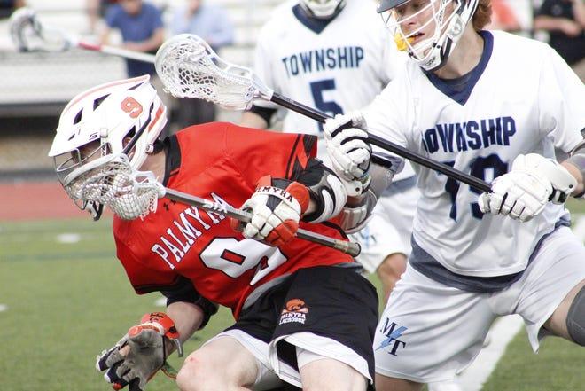Kyle Wasilewski (9) avoids Township defenders.