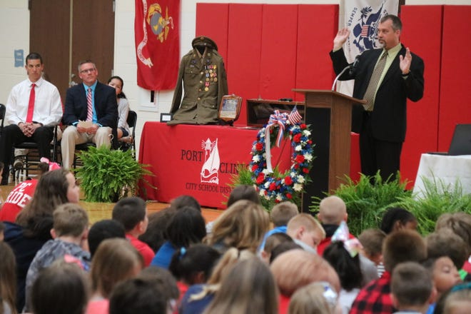 Bill Lowe, a local Marine veteran, discusses his military experience with students at Bataan Memorial Elementary School as part of their annual Bataan Day ceremony.