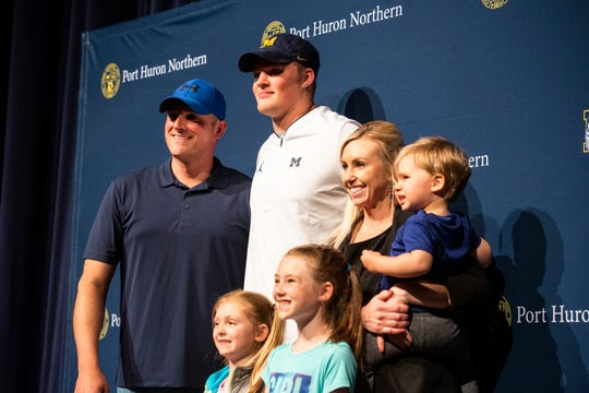 After announcing his college decision, Port Huron Northern junior Braiden McGregor, center, takes time to pose for photos with his family members Friday, May 24, 2019 in the auditorium at Port Huron Northern High School.