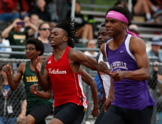 Roy C. Ketcham's Davonte Burgos takes second, as New Rochelle's Jessie Parson pulls ahead of him in the 100 meter dash during the Section 1 Class A Track & Field Championship in Freedom Plains on May 23, 2019.