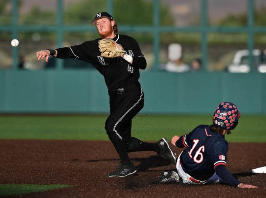 Nevada's Tyler Bosetti throws to first base for the double play as Fresno State's Nolan Dempsey slides into second base early in Thrusday's Mountain West tournament game.