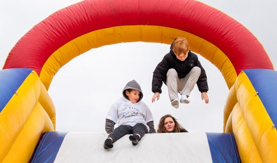 A large inflatable slide was a popular attraction for the students.