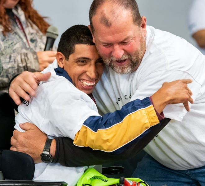 Mordachi Simon, from Dayton High School, is congratulated by Rob Jacobson, Fernley Intermediate School principal. Mordachi has participated every year since the Lyon County Olympic Games began nine years ago.
