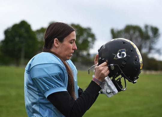 The Nevada Storm WR/CB Mo Oetjen puts her helmet on as she goes to practice at Mira Loma Park on May 21, 2019. The Nevada Storm is undefeated in their league.